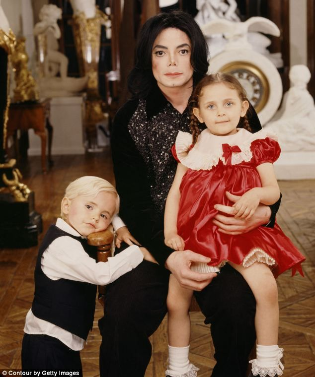 Pride and joy: Michael Jackson, pictured with his two oldest children Prince and Paris in 2001, was used by his family for money, something ...