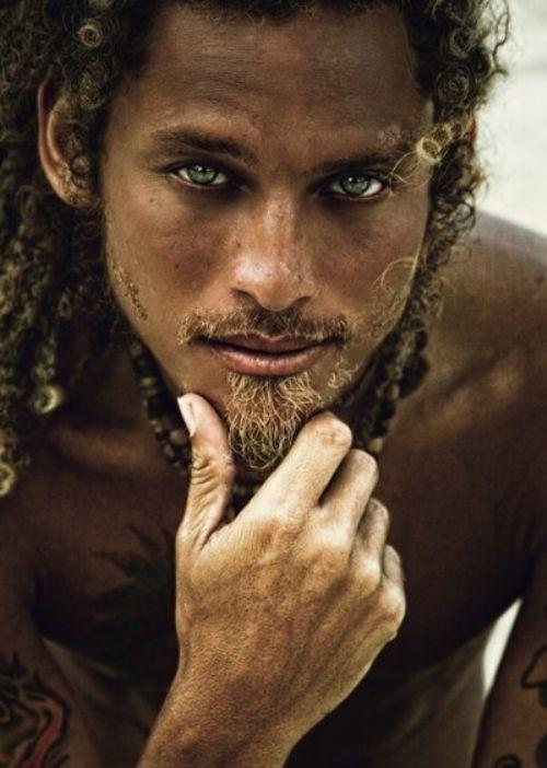 Dark skin. Curly hair. Colored eyes