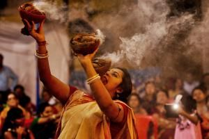 Durga Puja is the biggest and most important occasion of the year in Kolkata. The magnificence of the festival is revealed in these Durga Puja pictures.: Performing the Dhunuchi Dance