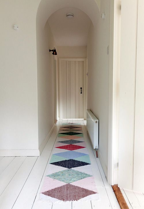 minimalistic - white arched hall with colorful diamond runner
