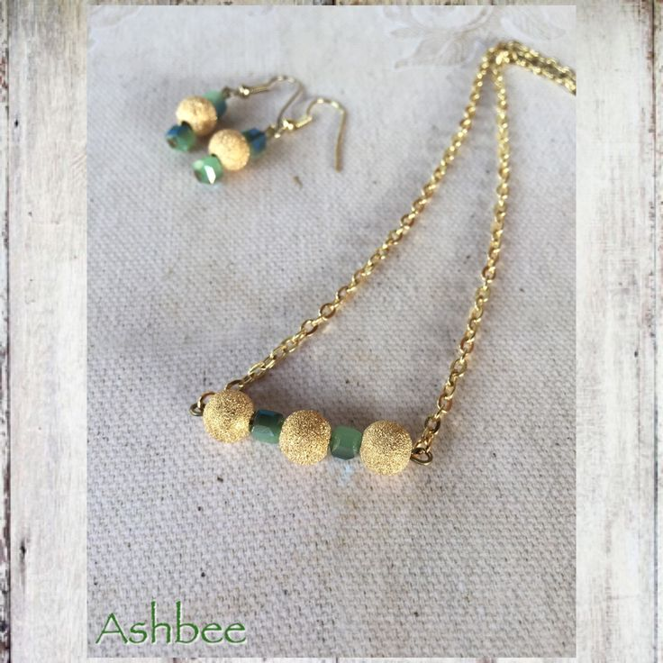 A personal favorite from my Etsy shop https://www.etsy.com/ca/listing/544170537/handmade-green-gold-bar-necklace-gold