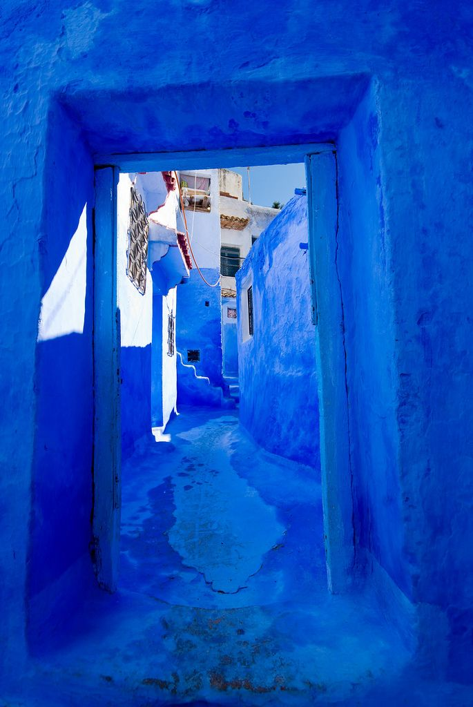 Backstreets of Chefchaouen, Morocco.   I remember going to a town in Morocco that areas really were painted blue like this. My impression of the place: white and blue. Loved it.