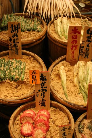 Nishiki Market Nukazuke | Pickles in Kyoto. The sandy looking stuff is nuka (rice bran). My m-i-l makes fermented veggies like daikon or cucumbers this way at home. #Japan #food