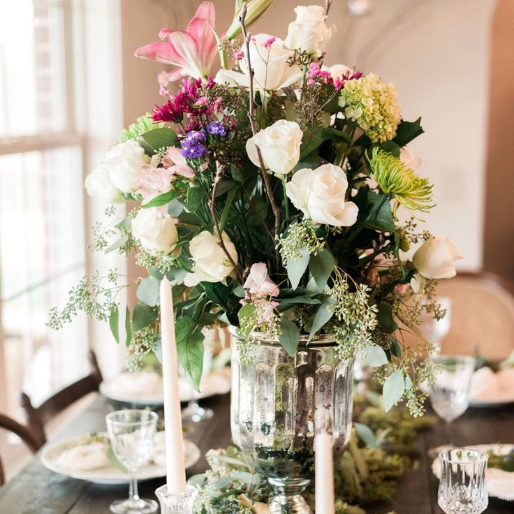 This floral centerpiece from Southern Knot Wedding & Event Rentals is both colorful and romantic.  For all of your wedding rental and floral needs, click the image above. Photo credit: Southern Knot Wedding & Event Rentals