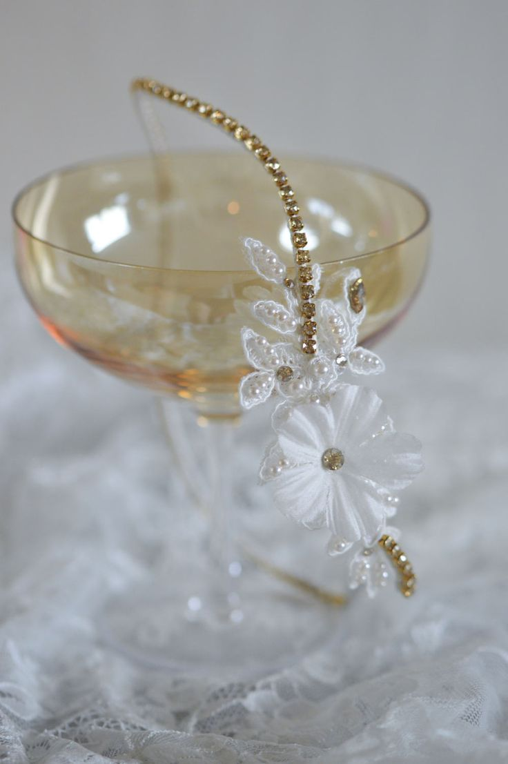 Bridal crystal headpiece,  made with lace, silk flower,  glass ivory beads and Golden Shadow Swarovski crystals.  Designed with the vintage bride in mind and creates a timeless look  with a touch of sparkle and glamour.  Handmade to order piece, will ship out in 5-10 days.  Each piece are handmade