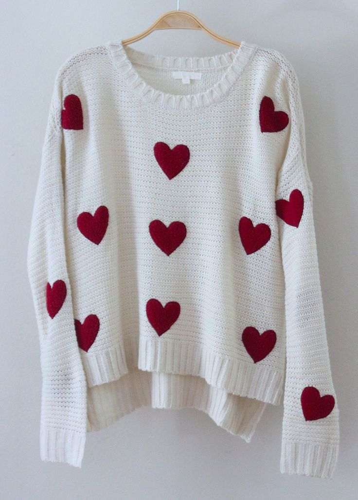 white wool shirt with medium sized red hearts
