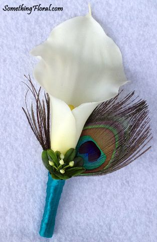 Realistic, artificial, white calla lily and genuine peacock feather boutonniere accented with budding foliage and a teal satin ribbon stem wrap.