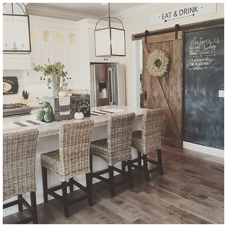 Neutral tones & textures, sliding KITCHEN - barnyard door, straw high back stools, light fixtures that are modern yet country, grey wooden floors - all make for a delightful kitchen space