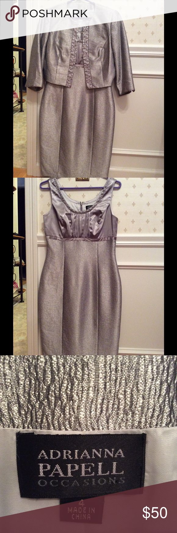 """Adrianna Papell Silver Occasion dress Authentic upscale Adrianna Papell silver embellished dress from her """" Occasion"""" line. Dress has grey satin bodice with silver yoke sparkles. Bottom is silver crinkle.  Fully lined.  Jacket is silver crinkle with silver embellishments at jacket closure.  Fully lined.  EXCELLANT condition.  Worn only for special occasion.  You will look beautiful in this dress Adrianna Papell Dresses"""