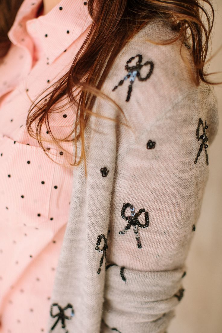 Bow embellished cardigan and a polka dot blouse