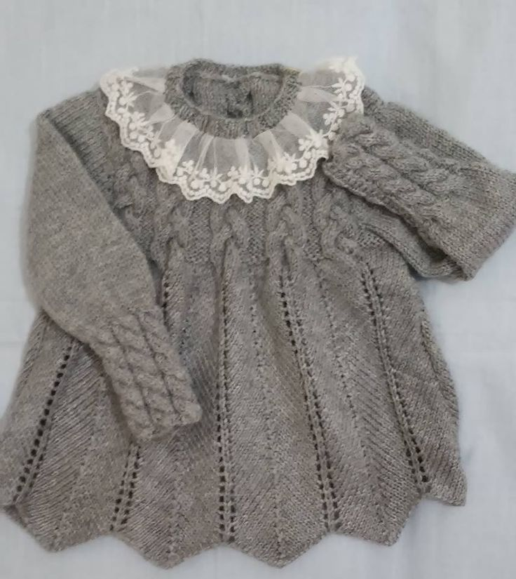 Cabled yoke sweater with razor shell or new shell body; tulle lace ruffle on neck