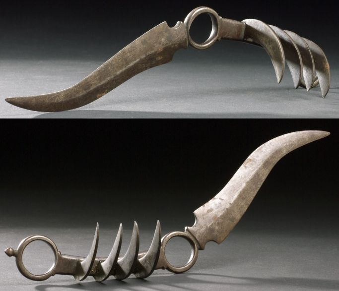 This rare and unusual palm weapon (vajra-mushti) is Indian, late 17 C., probably Central or South India. In a way it is a combination of a knuckle duster and a Bagh – Nakh Indian concealed weapon. It is held in the palm like a knuckle duster and has to long spikes of twisted steel extending to one side. Beautiful work in steel.
