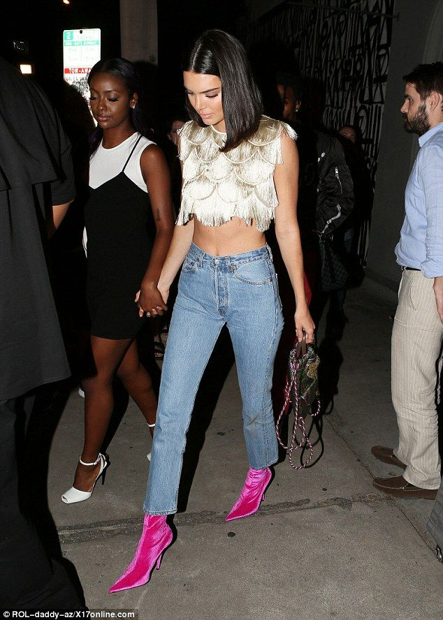 Hair today, gone tomorrow:Kendall kept her trademark raven tresses long and loose and par...