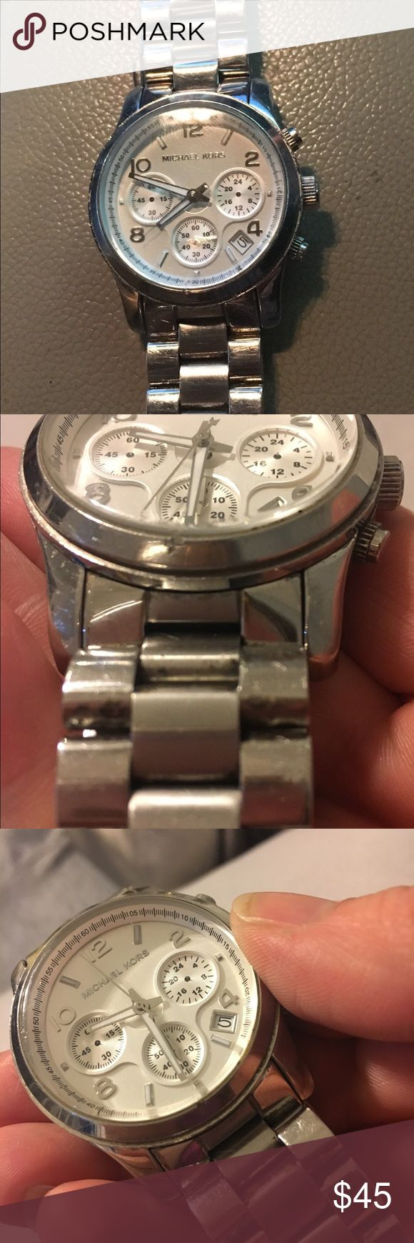 Authentic MK ladies watch Authentic MK ladies watch. Has been worn a lot. Couple links taken out so for a smaller wrist. Do not have the links. Battery works. One small nick at the bottom of the face on the silver part (near 6'oclock). Very small superficial scratch at same location on the actual face.  Picture uploaded of dent and got the scratch in a different picture the best that I could. Also scratches on the band and clasp from wear and tear. Accessories Watches