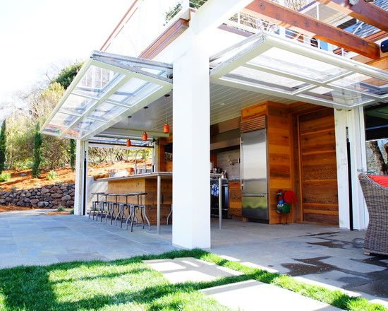 Great use of glass garage doors in the lower level for a true indoor/outdoor space!