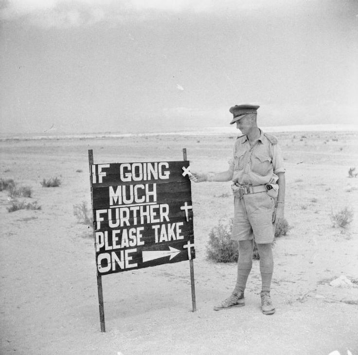 """""""If going much further please take one.."""" Typical 'Aussie' humour is reflected in this sign erected on the El Alamein road by Australian troops, 14 September 1942."""