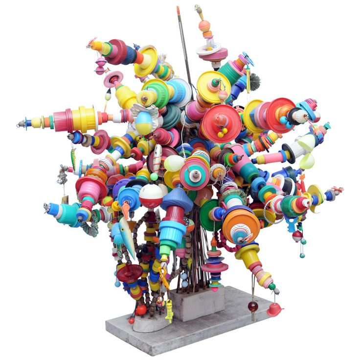 whimsical sculpture made of plastic lids and everyday bits and pieces by artist M. Ringo White.