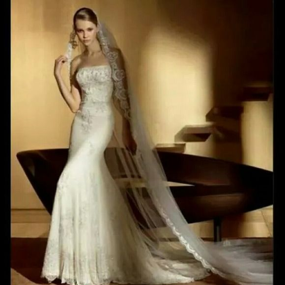 San Patrick wedding gown Fully beaded in Ivory color, absolutely beautiful. Never worn. Size 8. Paid 3000 for it. Do not have vail San patrick Dresses