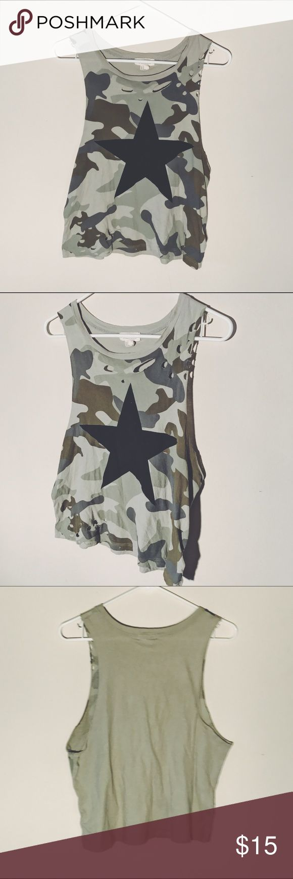 Distressed camouflage tank top/crop Very cute & distressed camouflage tank top/crop top. it came distressed from the manufacturer. it has holes all over the front and is so super comfortable. multiple shades of green & is in great used condition. size medium.   BUNDLE ➕ SAVE   ••• #guc #camo #camouflage #army #green #crop #holes #short #summer #thin Tops Tank Tops