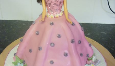 "Princess Doll Cake Caramel White choc mud skirt stacked on a 7"" Chocolate mud cake.... All fondant except for Tiara in hair...."