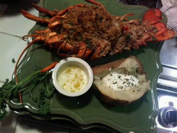 baked stuffed lobster plated with baked potato