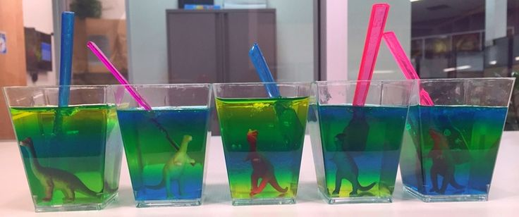 The park is open, and you're invited! Queue up Jurassic World and have a  viewing party (or an awesome birthday party) using these dino-mite party  recipes.   Prehistoric Dino Dig  Dig into these layered Jello cups to unearth mini dinosaurs captured  inside! A fun and interactive treat.       * 3 oz. box of Berry Blue Jello     * 3 oz. box of Island Pineapple Jello     * 3 oz. box of Lime Jello     * 3 cups of hot water     * 3 cups of cold water     * Clear plastic dessert cups     * Mini…