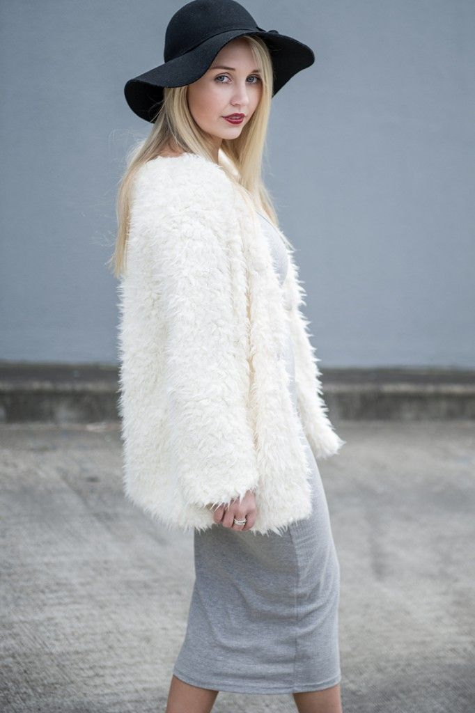 @theonlyblondeone wears Woollen Blend Cardigan was $169.00 now $55.00 and Knit Dress in Grey was $119.00 now $39.00