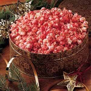Cinnamon Candy Popcorn Recipe- Recipes  This crisp bright-colored snack is more festive than traditional caramel corn. My family just loves! A friend shared the recipe, and I've given it to several people myself. Set out in pretty bowls, it makes a tasty table decoration. I also put it in sandwich bags for a children's party snack. -Kaye Kemper, Windfall, Indiana