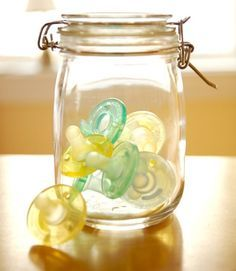 pacifier storage in a mason jar. oh but of course. WE ALREADY HAVE THEM with cream lace bows! perf.