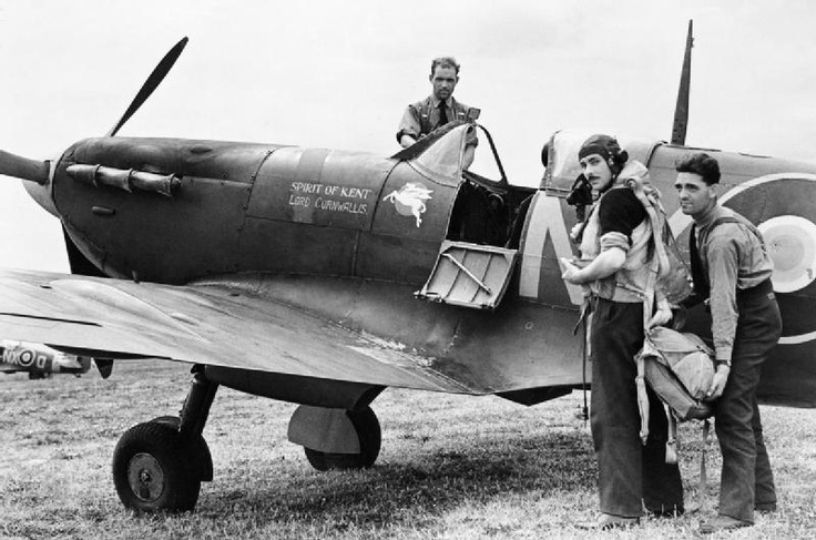 """Squadron Leader N G Pedley, the Commanding Officer of No. 131 Squadron RAF assisted by his ground crew, prepares to set out on a sweep in his Supermarine Spitfire Mark VB, BM420 'NX-A' """"Spirit of Kent/Lord Cornwallis"""", from Merston, a satellite airfield of Tangmere, Sussex. June 1942"""
