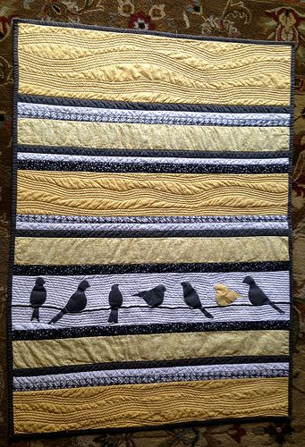 Beautiful bird quilt, and in my two favorite colors.  I wonder if the piecing would be easier to do since it is strips vs. squares?  Might be harder, keeping such long strips of fabric straight across the width of the quilt.