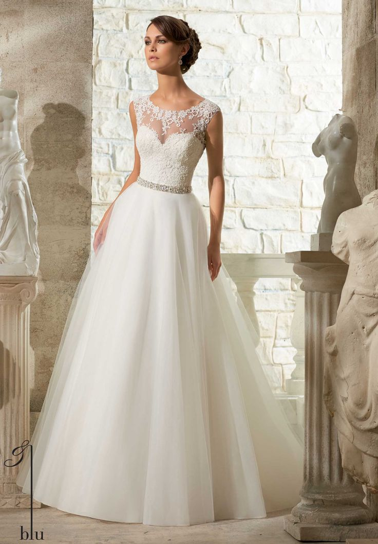 Wedding Gowns By Blu featuring Venice Lace Appliques on Soft, Tulle Ball Gown Available in White, Ivory. Removable beaded satin belt included. Belt also sold separately as style 11075.