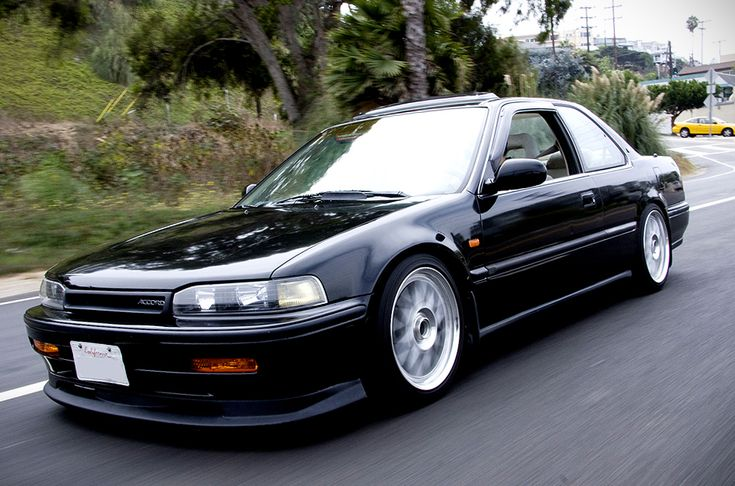 Old school! 92 Honda Accord with a sexy body kit :) You can keep your brand new whip, I'll take this!