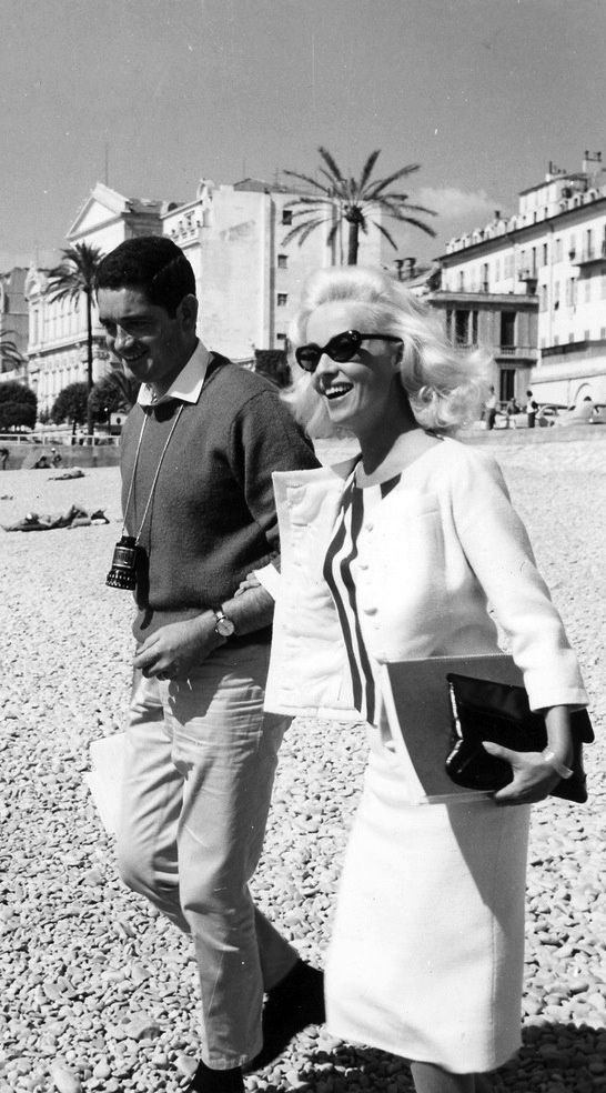 Jacques Demy and Jeanne Moreau on the set of 'La baie des anges' (1963).  Suit by Givenchy.