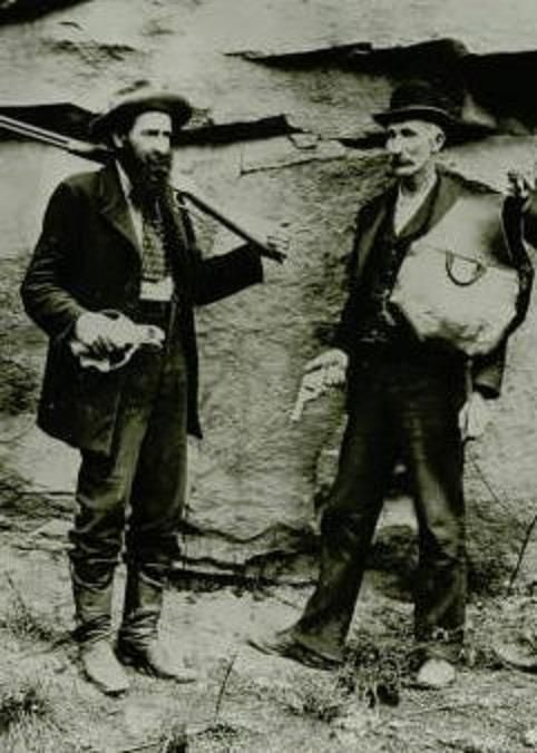 """Devil Anse Hatfield and """"Uncle"""" Jim Vance. Quite a difference from the Tom Beringer caricature. Instead of furs and skins Uncle Jim sports a suit and bowler."""
