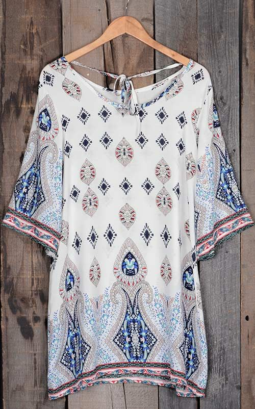 The print on this dress is literally perfection! This is very boho and we couldn't love it more. The cut of this dress is pretty amazing too! It's not too fitted and not too loose!