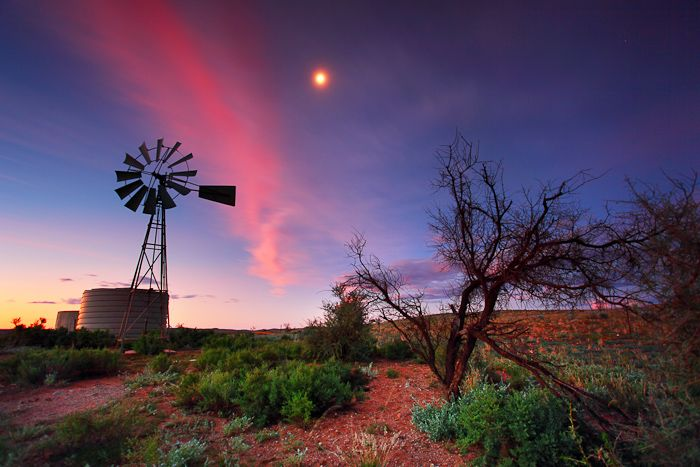 Country Moonrise  Broken Hill, NSW Australia    As the sky burst pink hues on sunset I ran up a small hill to find myself a better viewpoint and a great big windmill as well as a rising moon.