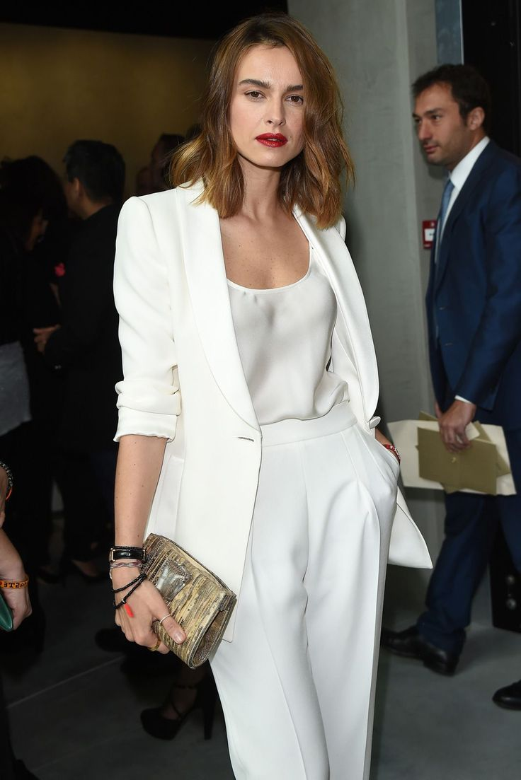 12 Women Who Chose Power Suits Over Party Dresses #refinery29  http://www.refinery29.com/armani-suit-party-pics#slide-9  Kasia Smutniak in a luxe all-white moment.