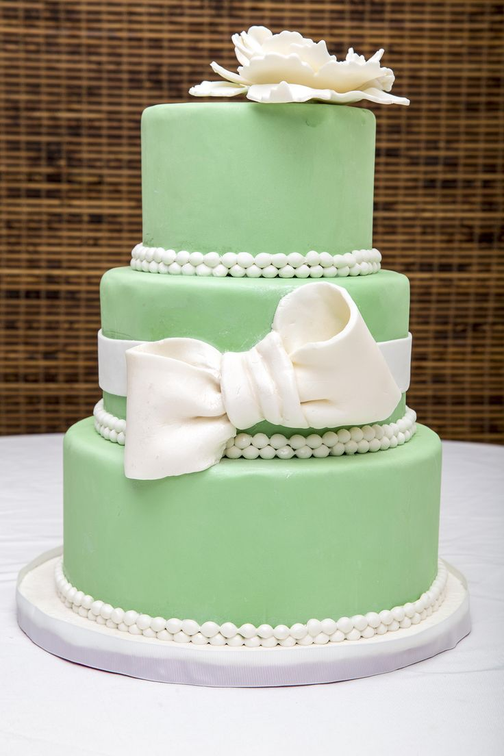 The Bow- Fondant with Pearl Boards decorative Bow and hand made flower.