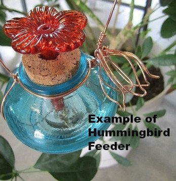 Use coupon code: PIN10 for 10% off! This glass #hummingbird #feeder is made of one red jar accented with brass, copper or nickel wire. First you choose your bottle, then choose the wire and your choice of bell ... #decorative
