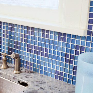 Small blue tiles add waterproof color to the often-damp area behind the sink, where wallpaper or paint might become a problem. Tiling a backsplash is an easy DIY job, particularly with tiny tiles that eliminate the need for a tile saw. The tiles come pre-attached to sheets of mesh to ensure proper spacing.