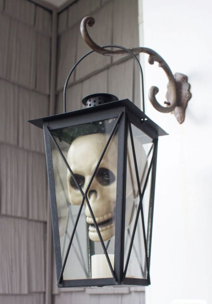 Skull in a lantern for outdoor Halloween decoration for the front porch