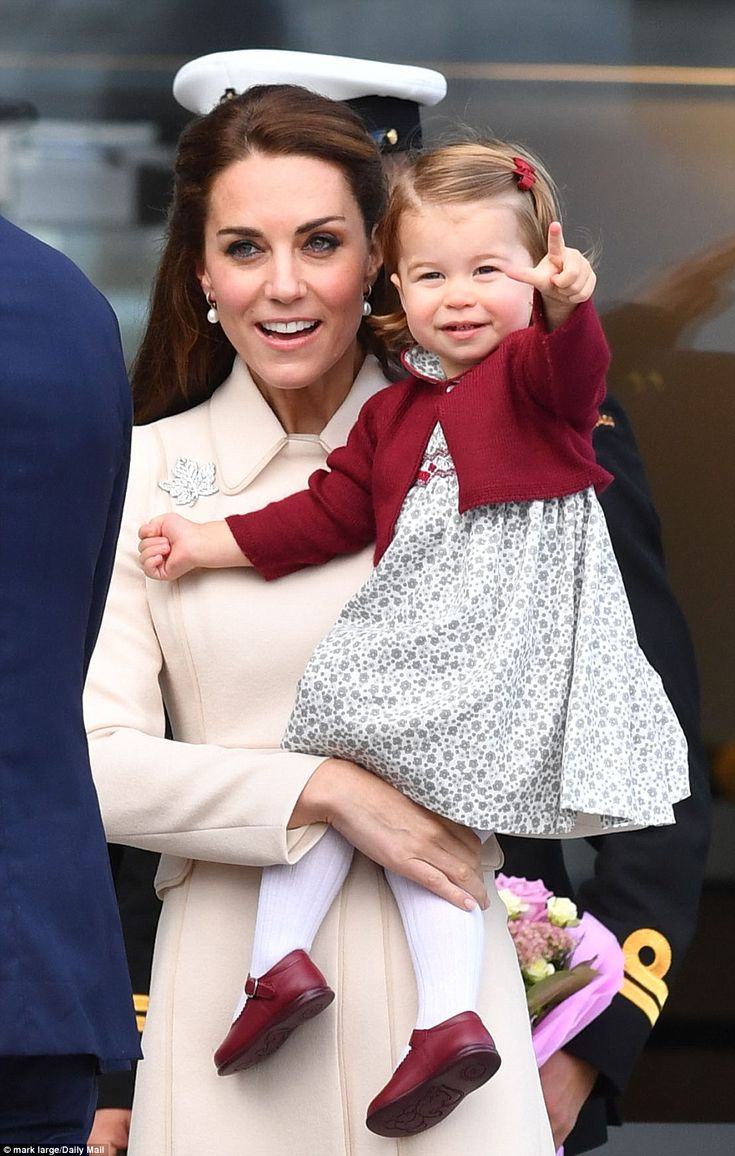 Princess Charlotte pointed excitedly as her mother held her in her arms before they boarded a seaplane to return home