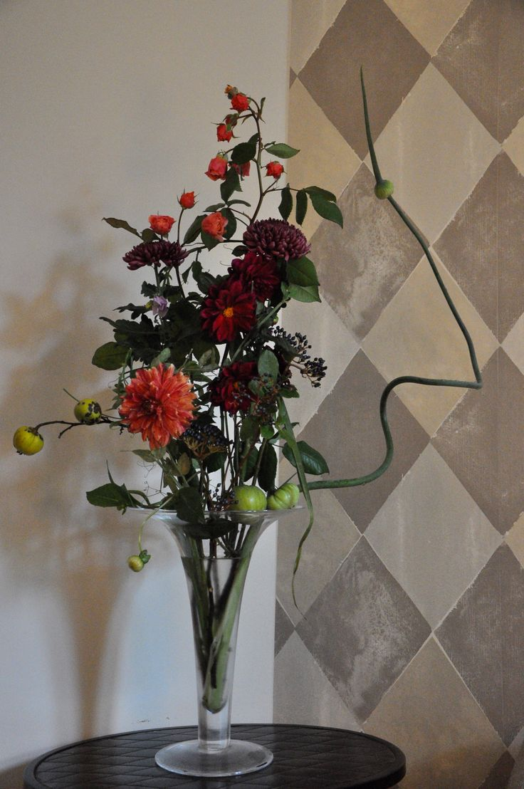 composition at parents home - garden gathering of green tomatoes, leek flower, dahlias, quince, lathyrus, chrysanthemums and roses.