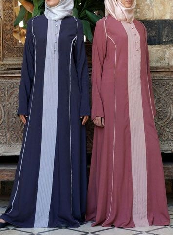 Contrast Pleated Abaya  The fun details are not to be missed in our new Contrast Pleated Abaya! The lovely colors are subtle enough for the office, modest enough for the masjid, and festive enough for a night out. The modest cut and breezy fabric allow for extra comfort, while the buttons and pleats add a bit of flair.