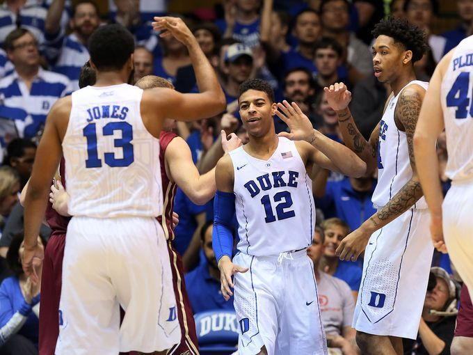 Duke Blue Devils guard Derryck Thornton (12) celebrates with guard Matt Jones (13) and guard Brandon Ingram (14) after he scored against the Elon Phoenix in their game at Cameron Indoor Stadium.  Mark Dolejs, USA TODAY Sports