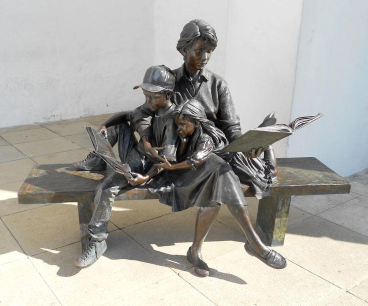 The Joy Of Reading is located in front the Bermuda National Gallery in Hamilton, Bermuda