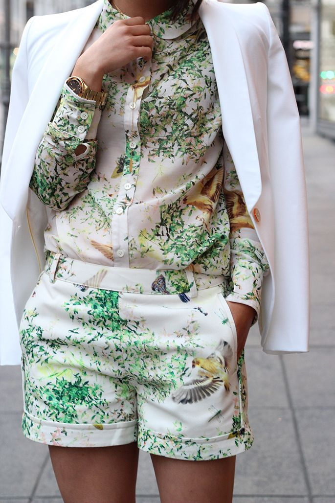 Flower Power!!! Floral prints are always interesting and this look is topped off by a white blazer! This outfit definitely has caught our attention.