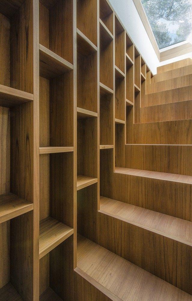 closeup of cool stair bookshelf ... Pinewood of Marina House | Architects: Massimo Fiorido Associati + sundaymorning | Location: Marina di Castagneto Carducci, Tuscany, Italy | Photographs: Fabio Candido
