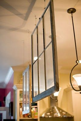 hanging old windows as a room divider - so clever!!!